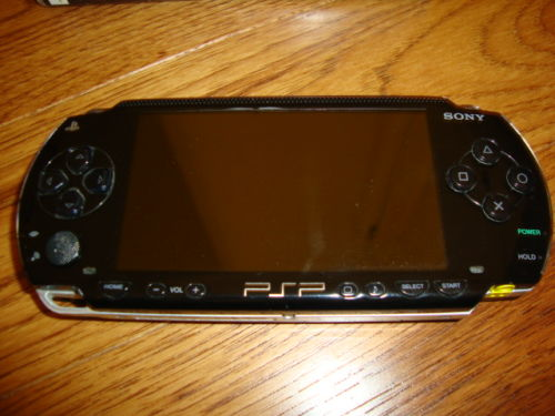 Sony-PSP-1001-+Charger-+9-Games-Excellent-Condition.jpg